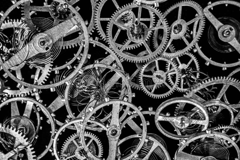 Antique clock mechanism steampunk style cogs gears wheels royalty free stock photo