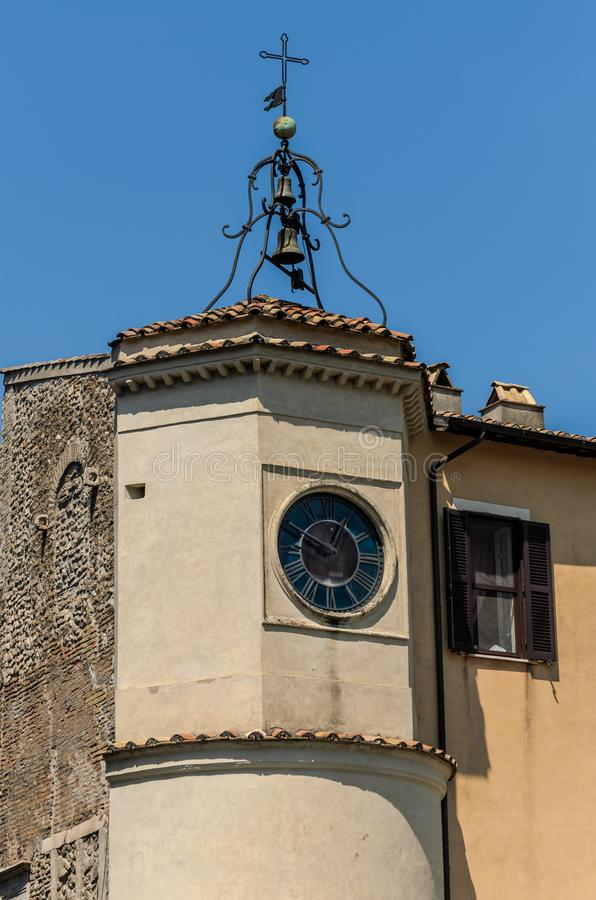 Antique clock tower and bells in the old European city.  royalty free stock image