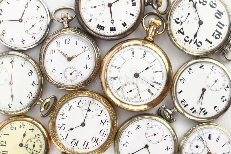 Antique clocks. Various Antique pocket watches on white royalty free stock images