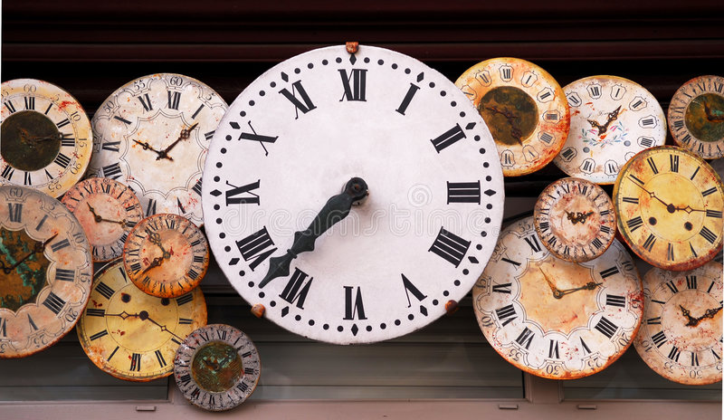 Antique clocks. Several antique clock faces of different sizes and styles royalty free stock photo