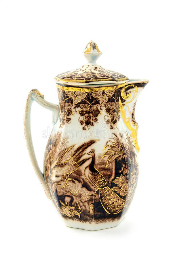 Antique coffee pot of historicism time area. Antique coffee pot of historicism time area around 1860. floral ornaments and peacock birds. isolated white royalty free stock images