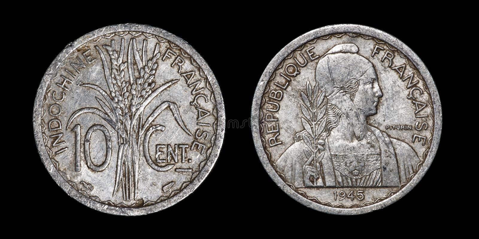 Antique coin of 10 centimes. Antique coin isolated on black macro view stock photos