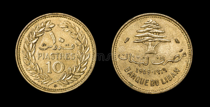 Antique coin of 10 piastre. Antique coin of Liban isolated on black macro view royalty free stock photos
