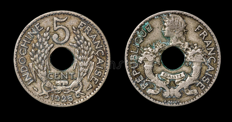 Antique coin of 5 centimes. Antique coin isolated on black macro view royalty free stock photo