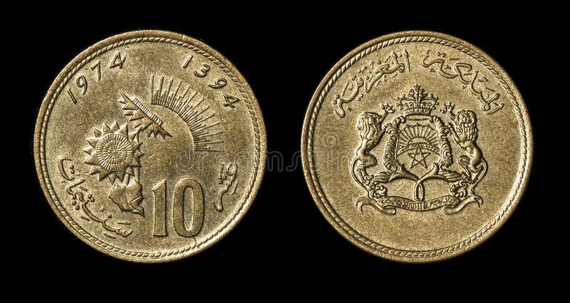 Antique coin of african country. Antique coin isolated on black macro view stock image