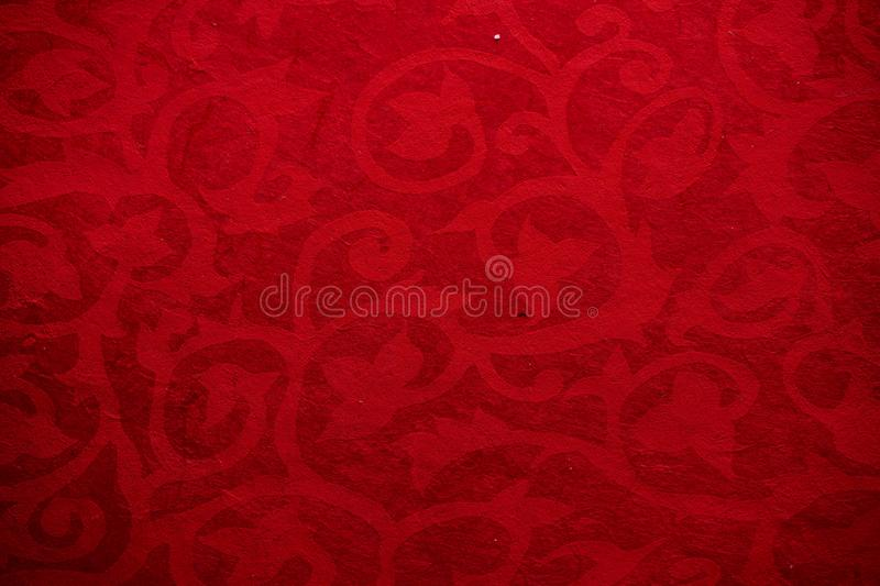Antique colored paper background texture with dark in old distressed vintage design. Colour of paper red, christmas texture stock illustration