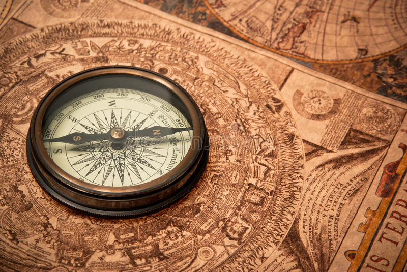 Antique Compass on Map