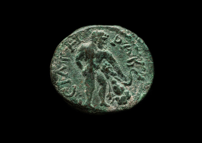 Antique copper coin of Roman province Troas. Close-up shot, isolated on black stock photos