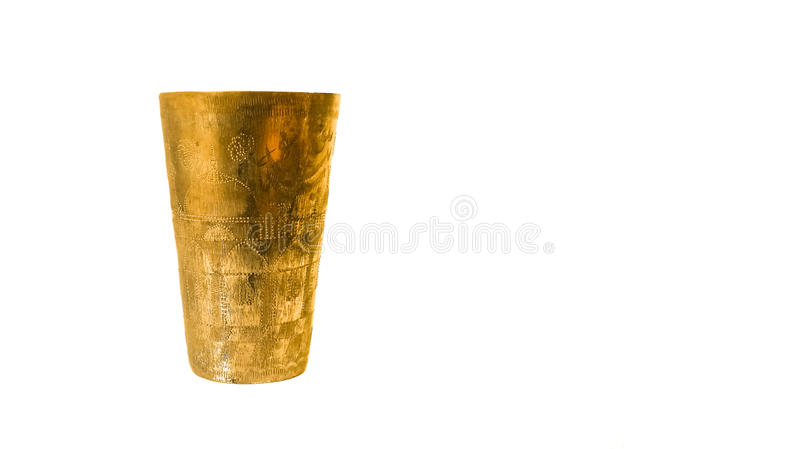 Antique copper cup. On a white background royalty free stock image