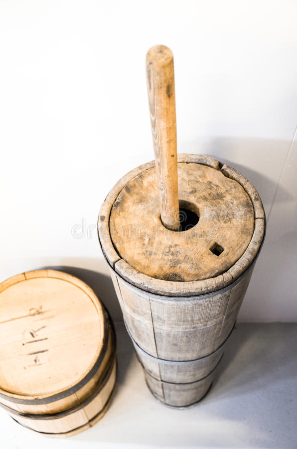 Antique country wooden butter churn, Iceland. The churn is an old device used to convert cream into butter stock image