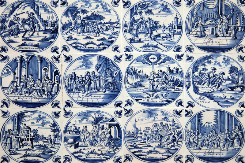 Antique Delft wall tiles. Close up of antique tin glazed blue Delft wall tiles dating from 1750-80, showing biblical scenes royalty free stock photography