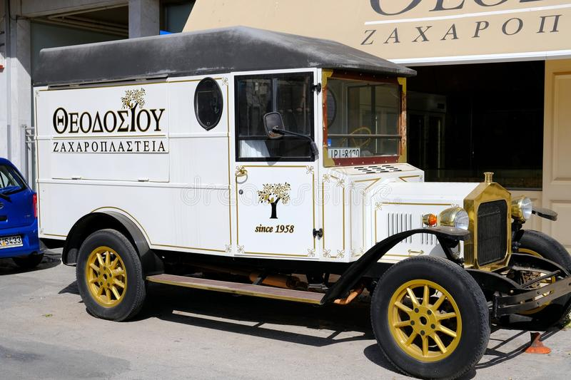 Antique Delivery Van at a Greek cake Shop, Greece. An early 20th century antique delivery van belonging to a traditional cake and cookie shop in Rafina, near stock photography