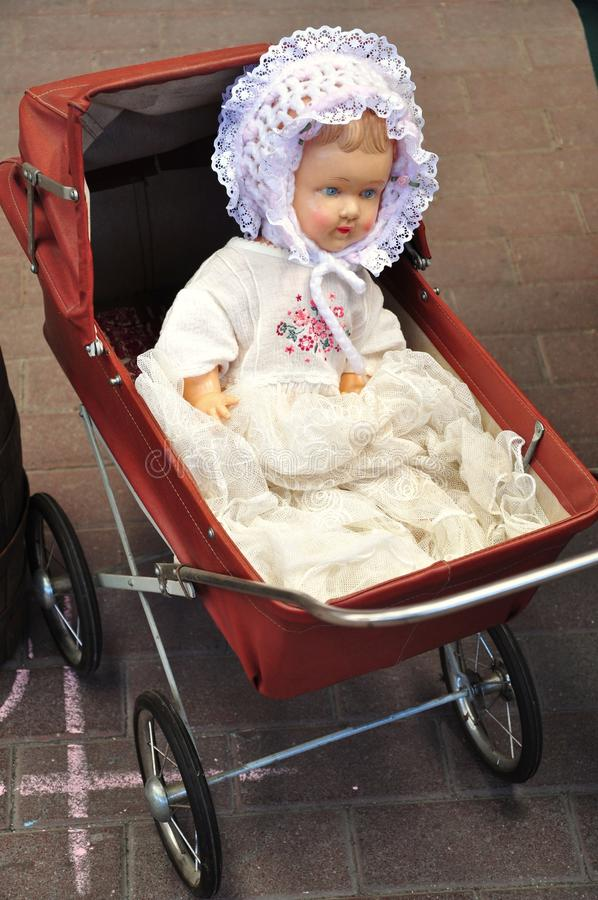 Antique doll in cradle stock photo