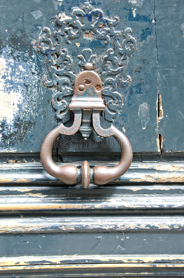 Antique door-knocker on old door stock photography