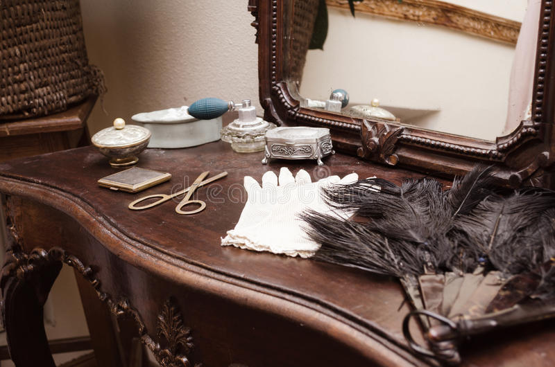 Antique dressing table with mirror. In the interior stock image