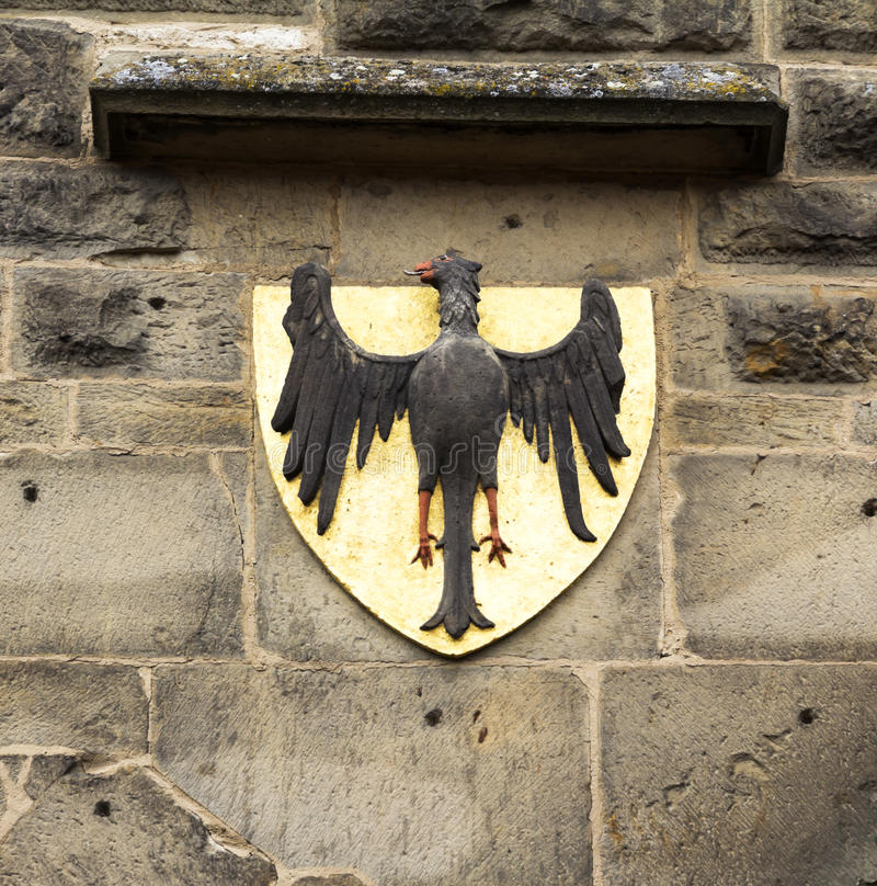 Antique eagles. Emblem on the wall of old tower in Rothenburg od der Tauber royalty free stock photography