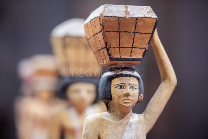 Antique egyptian statuette close up. Beautiful art statuette form ancient egypt stock photos