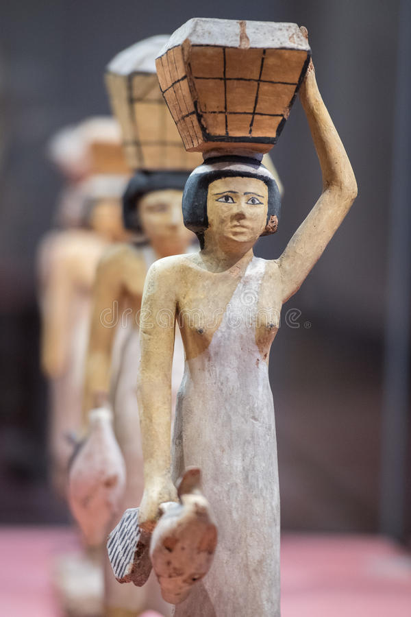 Antique egyptian statuette close up. Beautiful art statuette form ancient egypt stock photography
