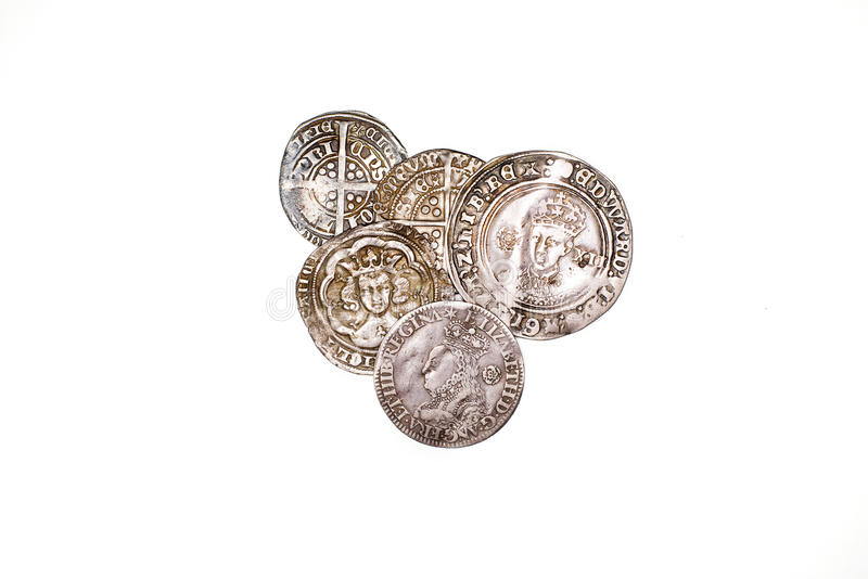 Antique England and France Silver coins on white background. A lot of old silver coins with portraits of kings on a white background stock images