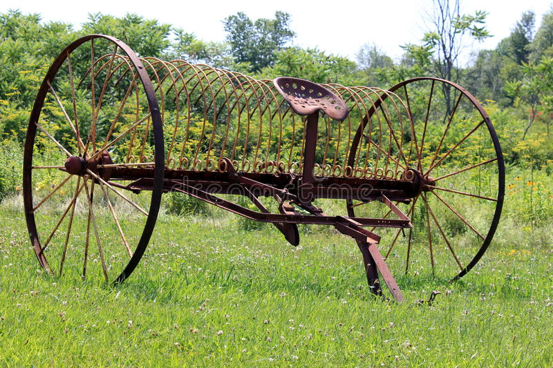 Antique farm equipment stock image