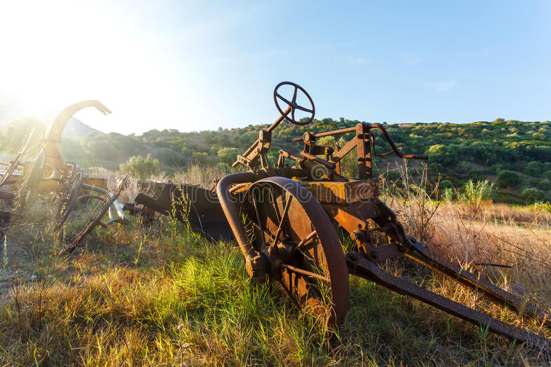Antique Farm Equipment at sunrise, Italy. Antique Farm Equipment and Old hay rake at sunrise, Italy royalty free stock photography