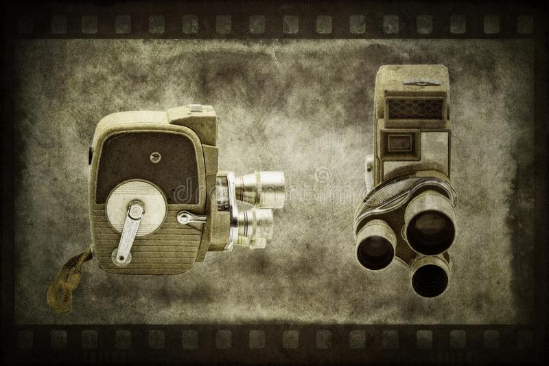 Antique Film Home Movie Camera. Front and side view of an antique home movie camera that uses film. Photograph features rotating lens turret with three lenses royalty free stock photos