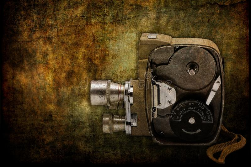 Antique Film Home Movie Camera with Opened Side Case. Antique film home movie camera side view while the case is opened to the film spools. Photographed against royalty free stock images