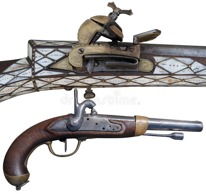 Antique flintlock rifle and percussion pistols. Evolution of Firearms. Evolution of Firearms. Antique flintlock rifle and percussion pistols stock images