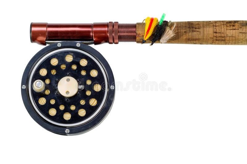 Antique fly reel and rod on white background. Antique fly fishing reel, flies and rod isolated on white background stock photos