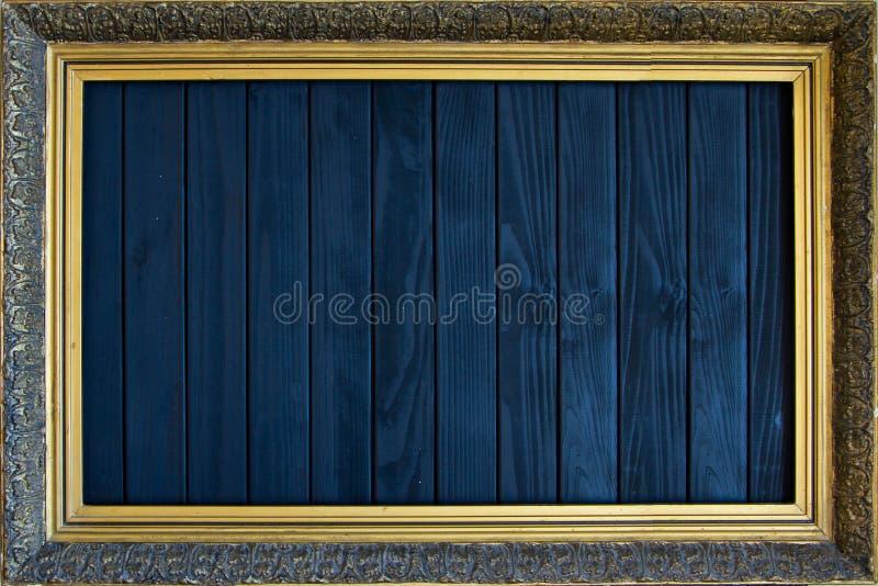 Antique frame with gold leaf on a black background royalty free illustration