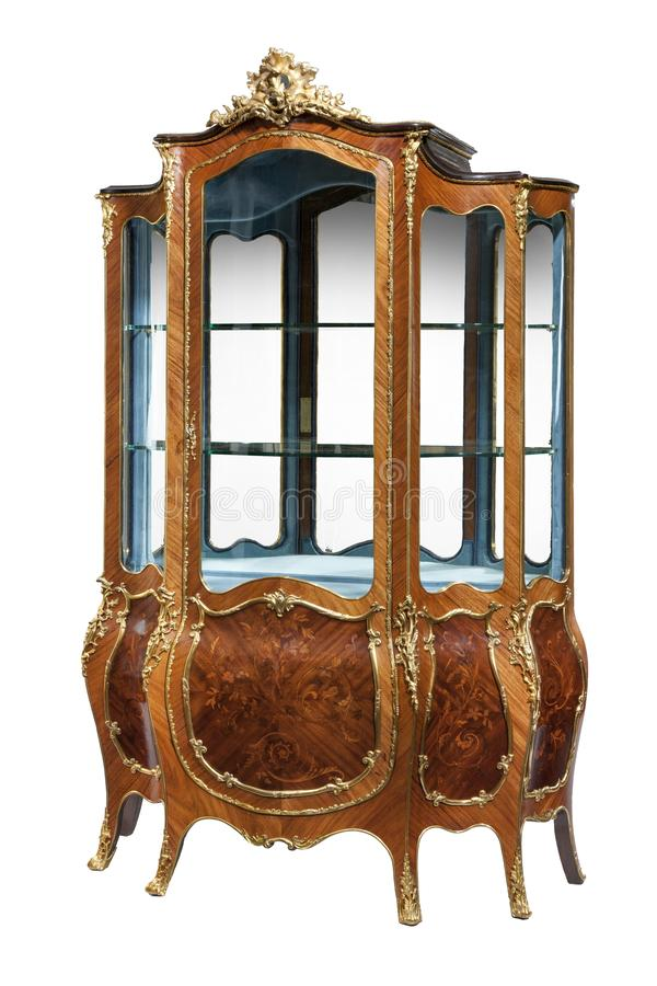 Antique French style display cabinet. Vintage French style display cabinet with ormolu gold mounts isolated on white stock image