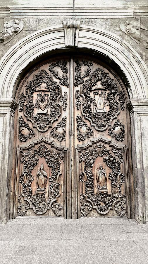 The antique front door of San Agustin Church in Intramuros Manila, Philippines. Bricks, wood royalty free stock photos
