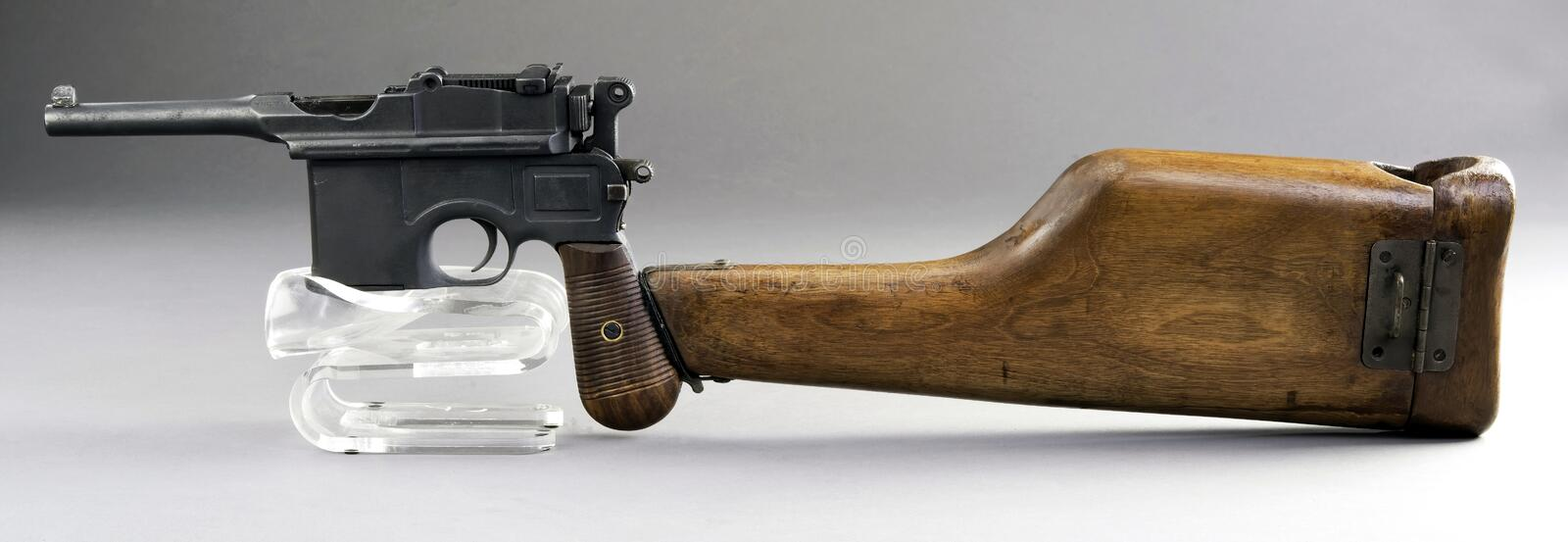 Antique German Broomhandle Pistol. Made around 1926 with attached wooden shoulder stock royalty free stock photos