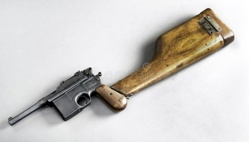 Antique German Broomhandle Pistol. Made around 1926 with attached wooden shoulder stock stock photography