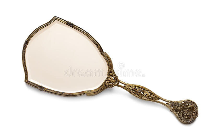 Antique Gilded Hand Mirror over White. Vintage antique gilded hand mirror, isolated on white background royalty free stock image
