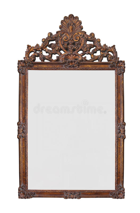 Antique gilt mirror isolated. Antique fancy hand carved brown wooden gilt mirror. Isolated on white stock photos