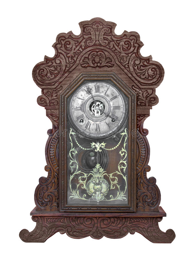 Antique gingerbread clock isolated. Antique gingerbread style clock with hand-carved wooden case. Isolated on white stock photography