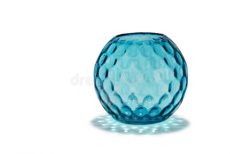 Antique glass vase round and patterned dimple effect. Old vintage antique blue glass vase with striking dimple pattern effect stock image
