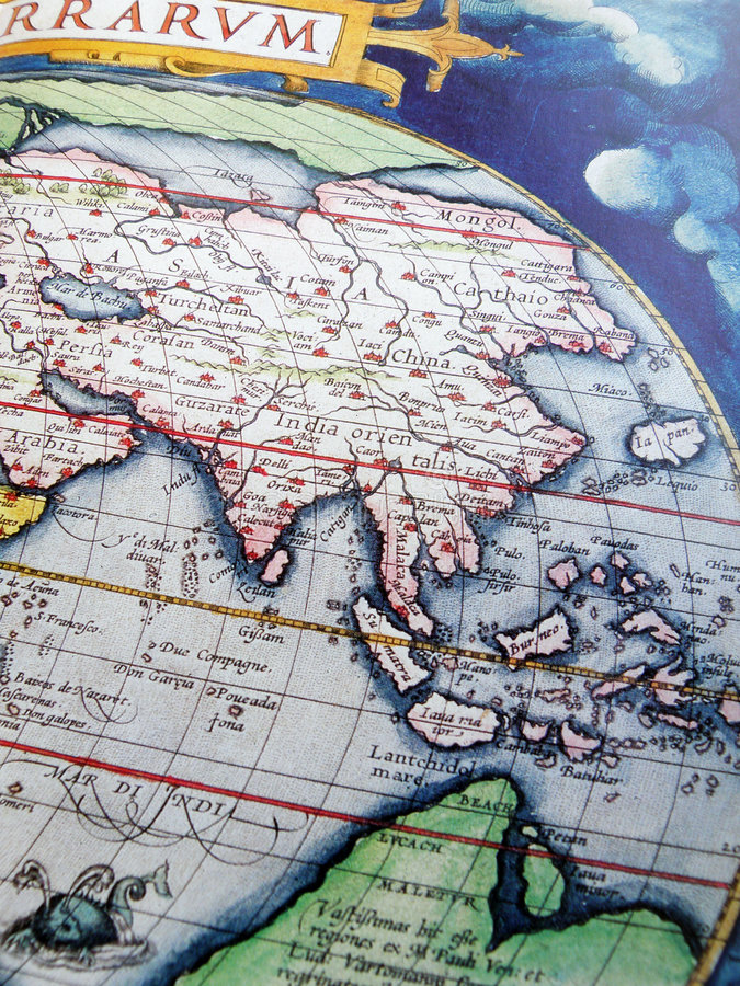 Antique globe, Asia. An old aged antique map showing the asia region. Vertical color format. Particularly focusing on the southeast asian vicinity, showing stock images