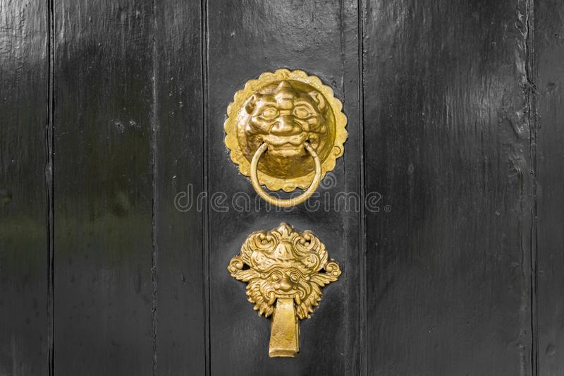 Antique gold or brass door knocker ornate royalty free stock photo