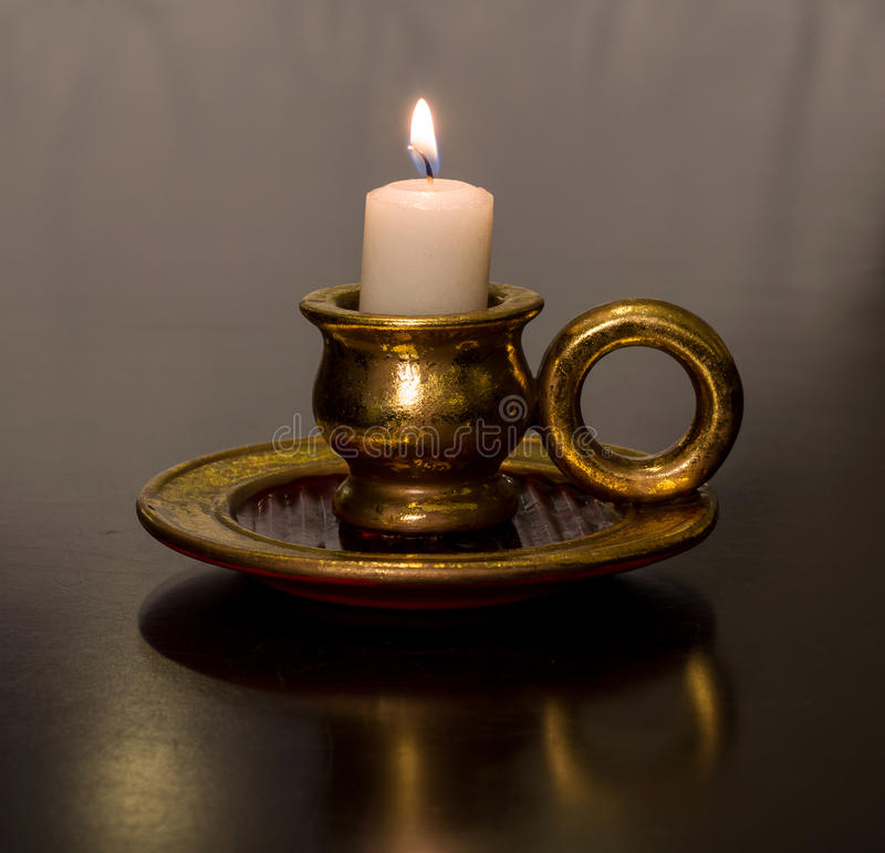 Antique gold burning Wax candle. Antique beayutiful gold burning Wax candle stock images