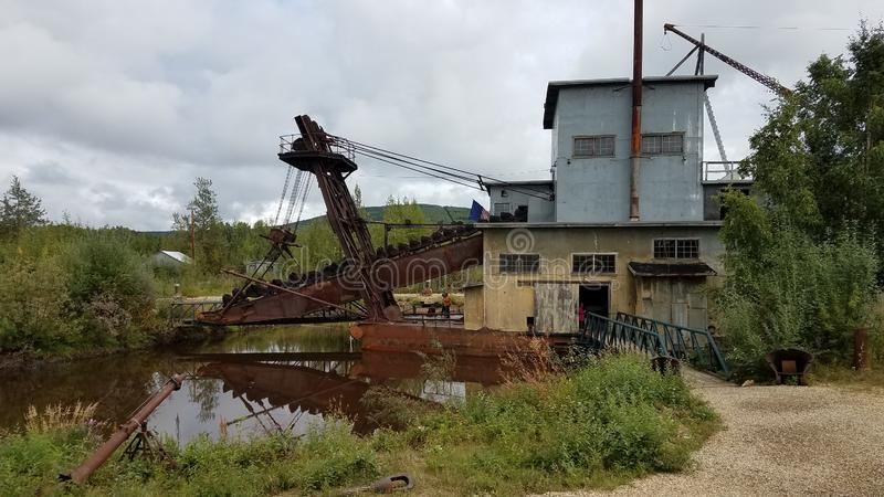 Antique Gold Dredge Fairbanks Alaska. Antique Gold Dredge near Fairbanks Alaska. A gold dredge mines gold from sand, gravel and dirt. This is an original gold stock image