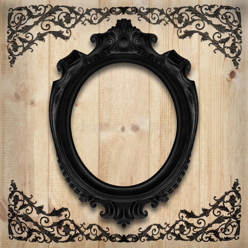 The Antique gold frame on wooden wall;. Empty Antique gold picture frame on wooden wall. royalty free stock photography