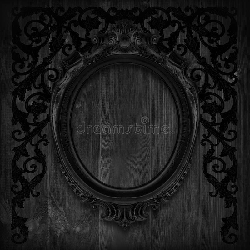 The Antique gold frame on wooden wall;. Empty Antique gold picture frame on wooden wall. stock photo