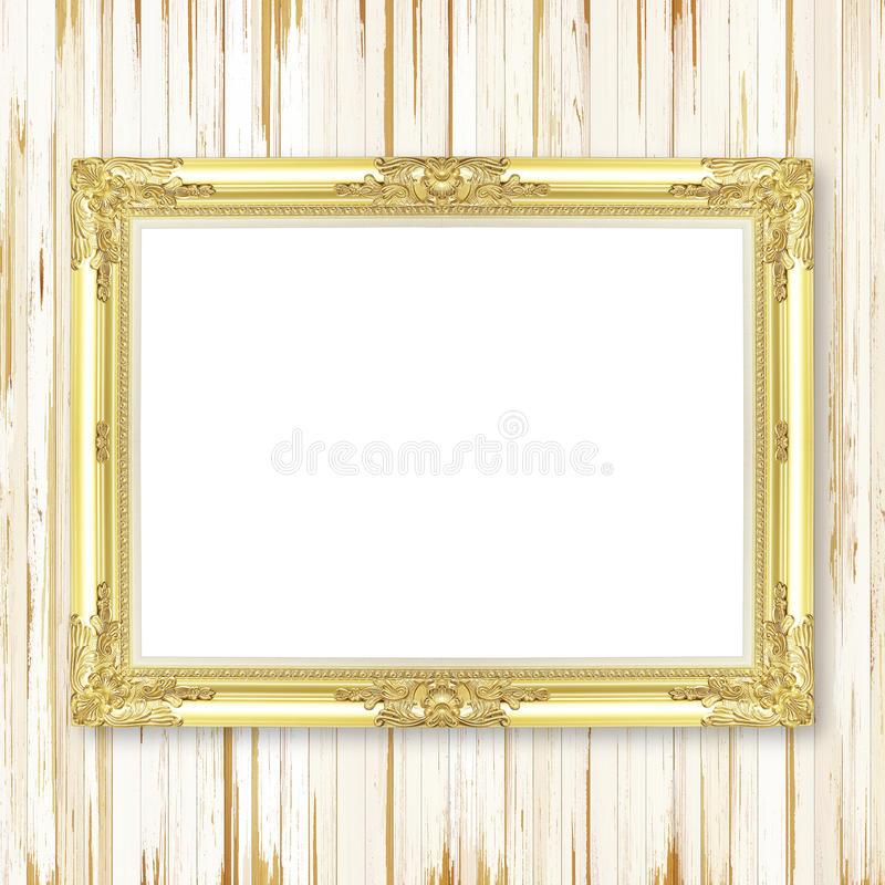 Antique gold frame on wooden wall royalty free stock images