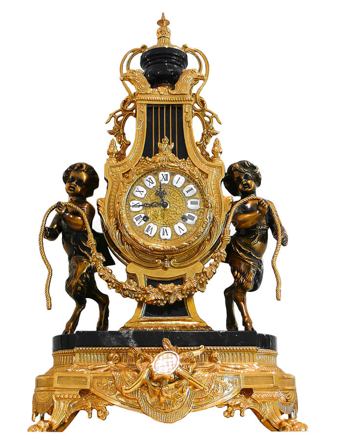 Antique Gold mantle clock royalty free stock image