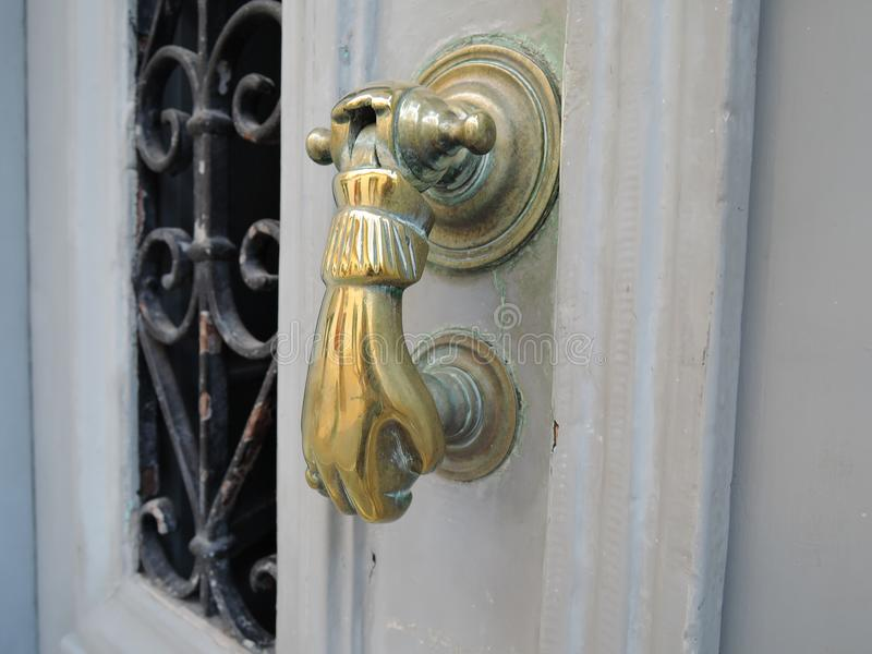 Antique golden door handle on an old wooden door stock photography