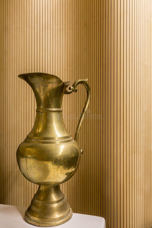 Antique golden jug royalty free stock images