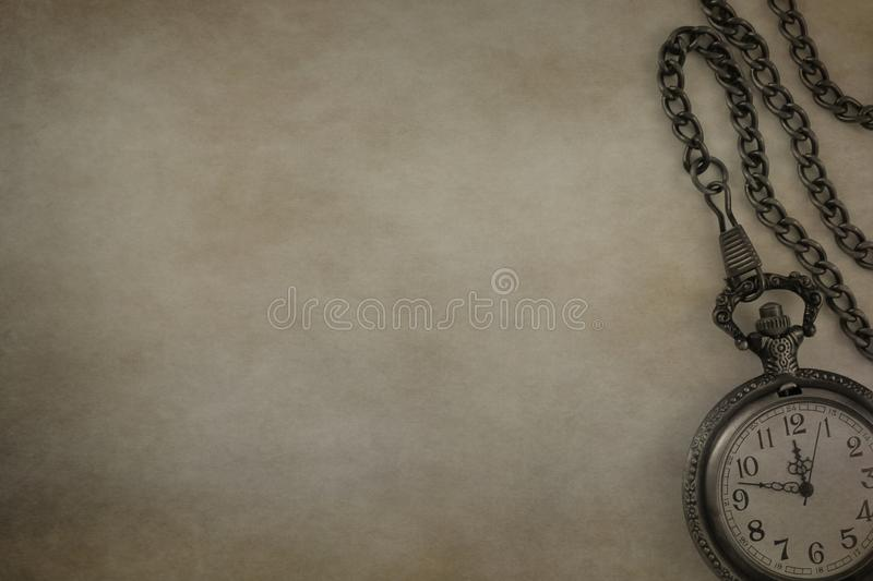 Antique gray metal pocket watch with chain isolated on colorful textured background stock images