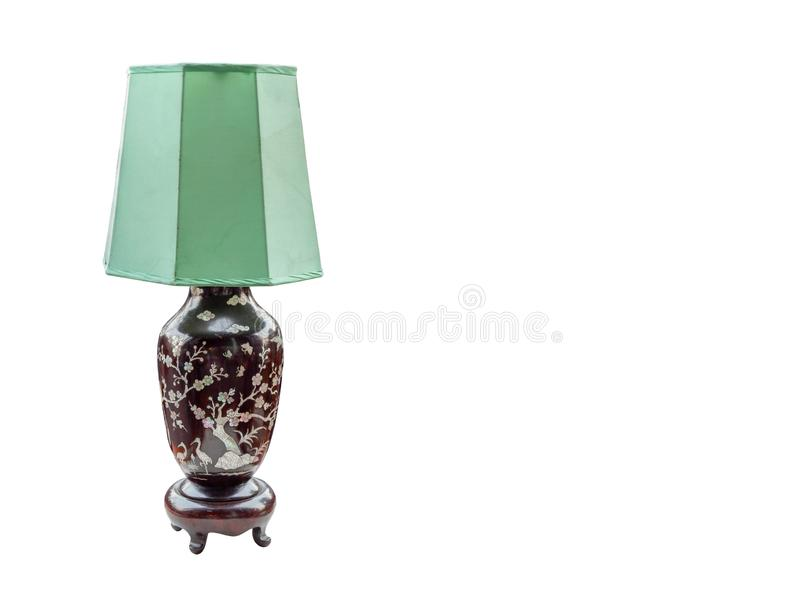 Antique green and brown lamp on white background, vintage, object, copy space royalty free stock images